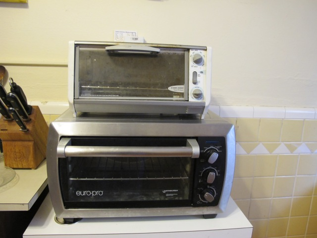 The new toaster oven (bottom) could eat the old toaster oven for breakfast!